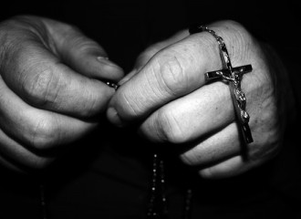 hands-with-rosary-beads